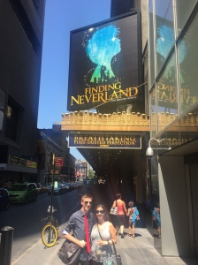 In front of the theater entrance